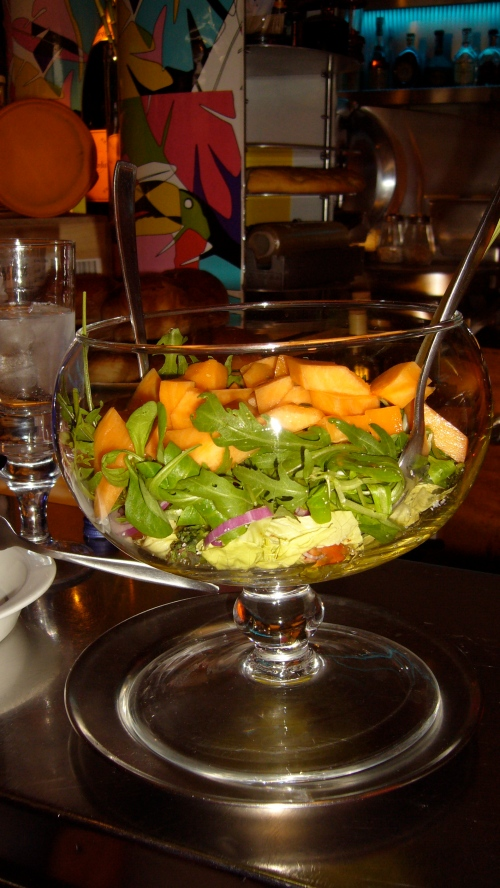 Veggie salad with cantaloupe, butter lettuce, arugula, heirloom tomatoes, red onion, basil, salt, pepper and Ringo's special mustard with extra virgin and aceto red wine vinegar served in a fish bowl
