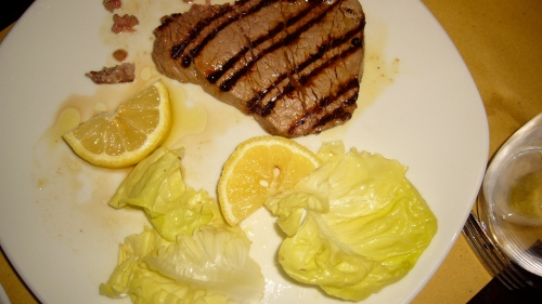 Grilled steak with lemon