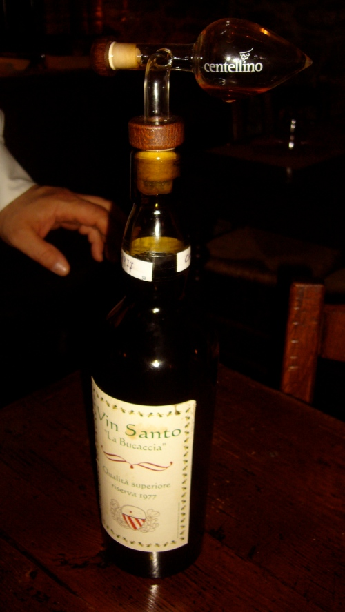 "Vin Santo ""La Bucaccia"" riserva 1977 shown with the decanting pourer"