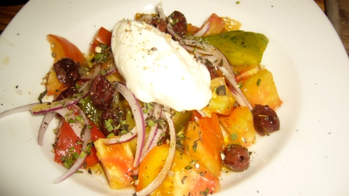 A new style greek salad comes together with Marinated Heirloom Tomato, Feta Mousse, Red Onion and Olives.  The creamy, sorbet-like feta mousse balances the sharpness of the olives.